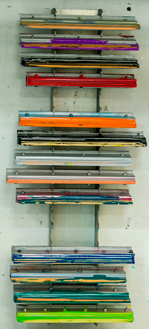 Here you see a row with squeegees. We use them when we make direct printing